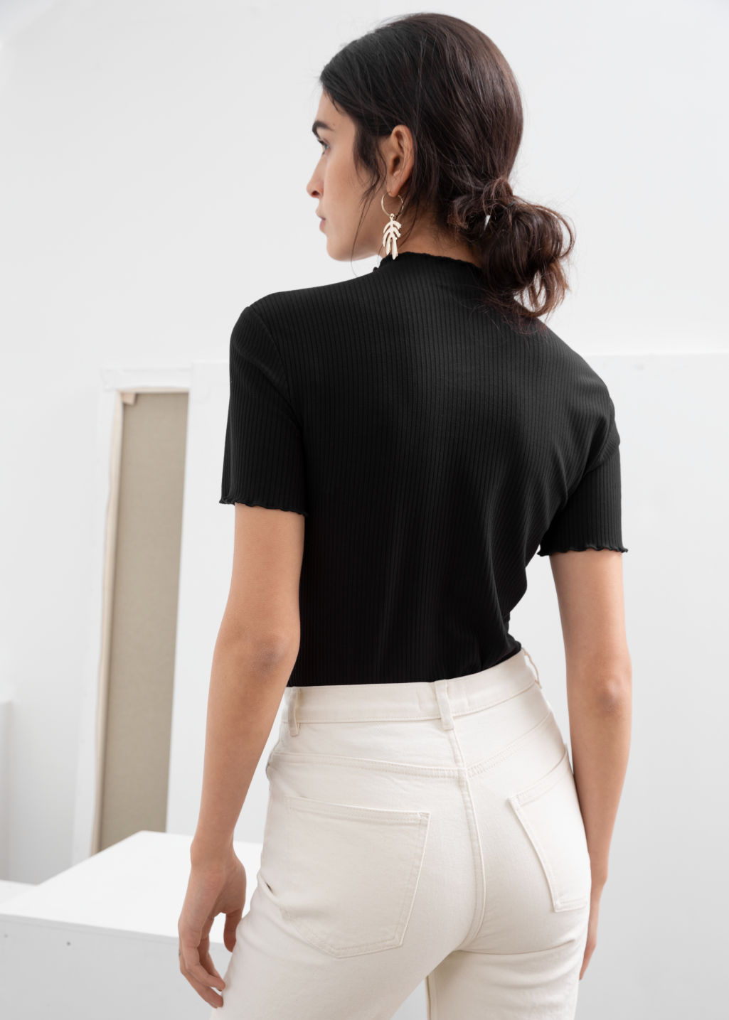 Model back image of Stories stretch rib knit top in black