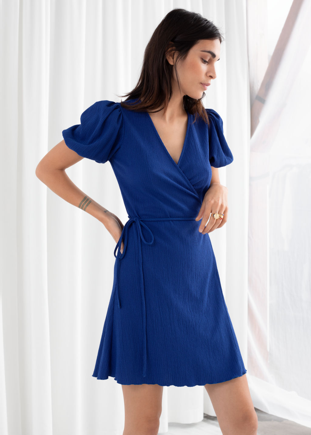 Model front image of Stories puff sleeve ribbed mini wrap dress in blue