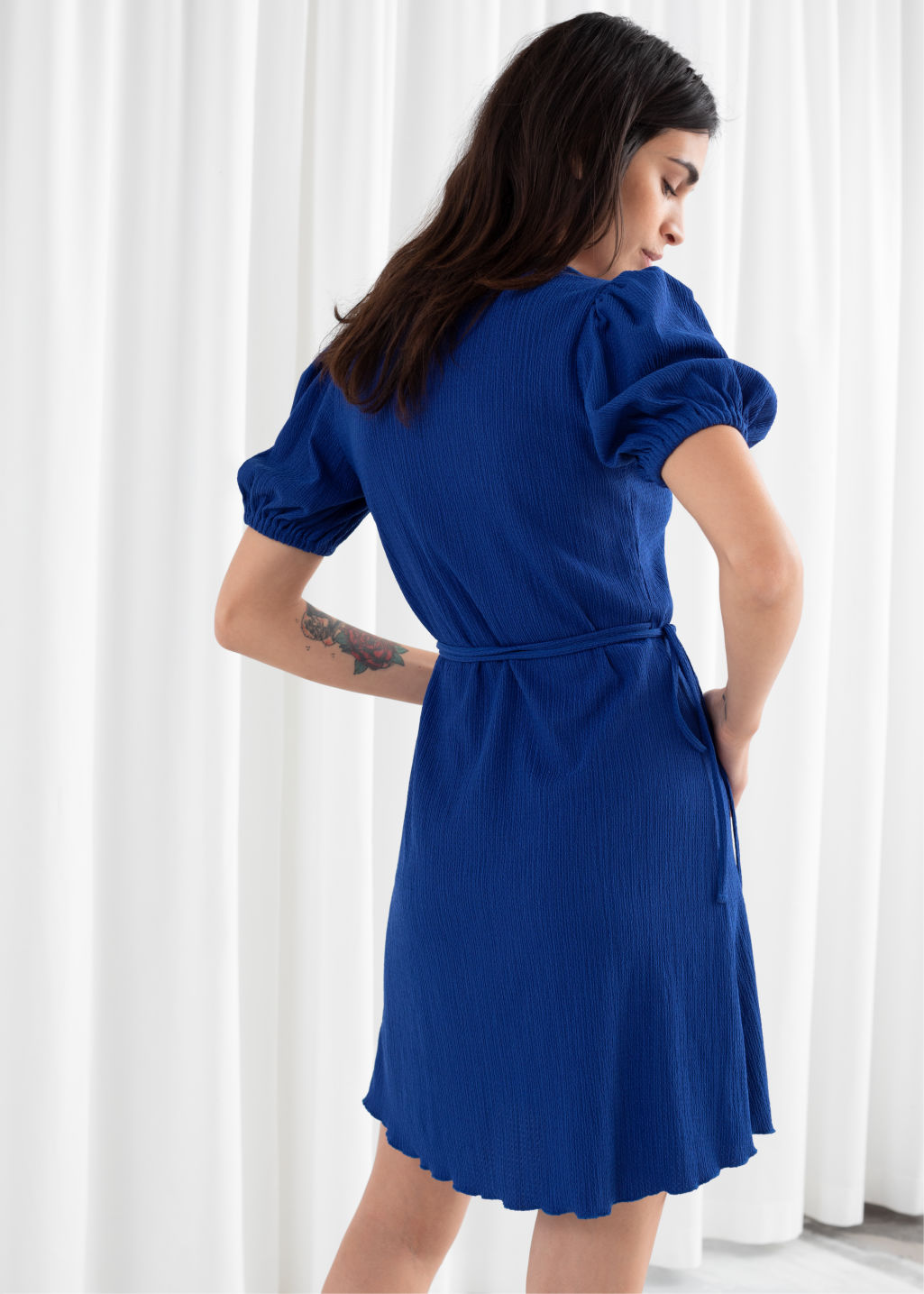 Model back image of Stories puff sleeve ribbed mini wrap dress in blue