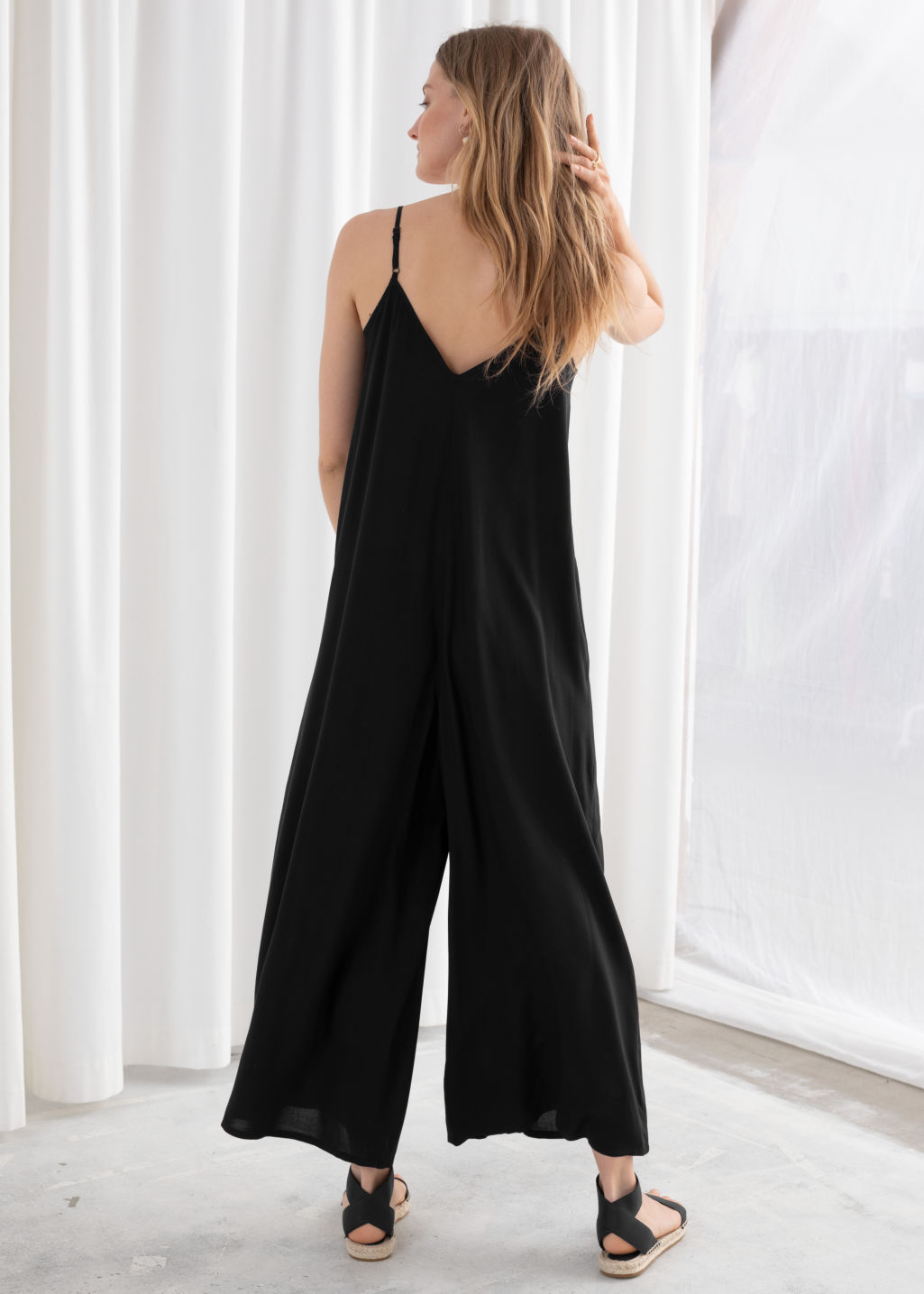 Model back image of Stories relaxed spaghetti strap jumpsuit in black