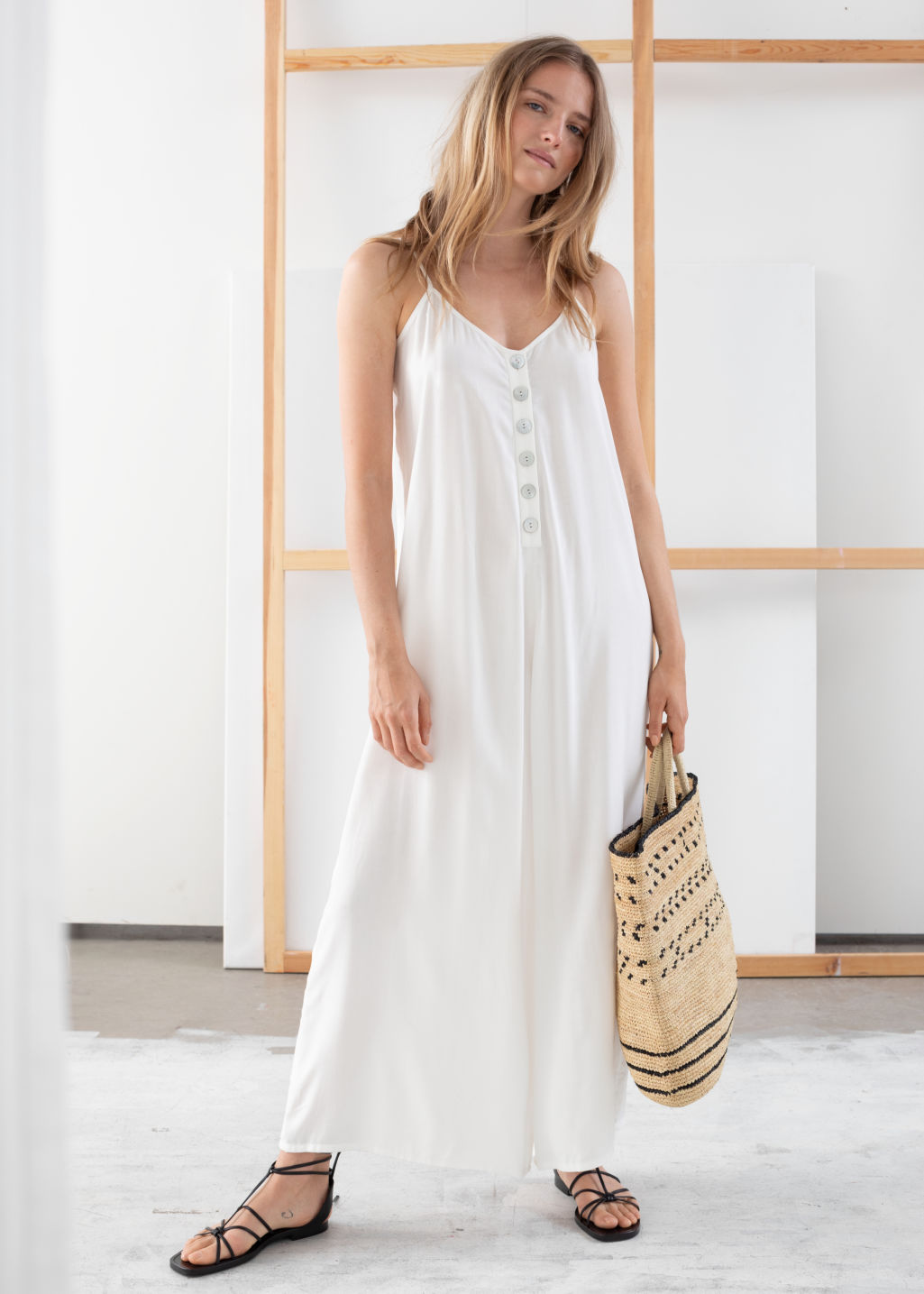 Model front image of Stories relaxed spaghetti strap jumpsuit in white
