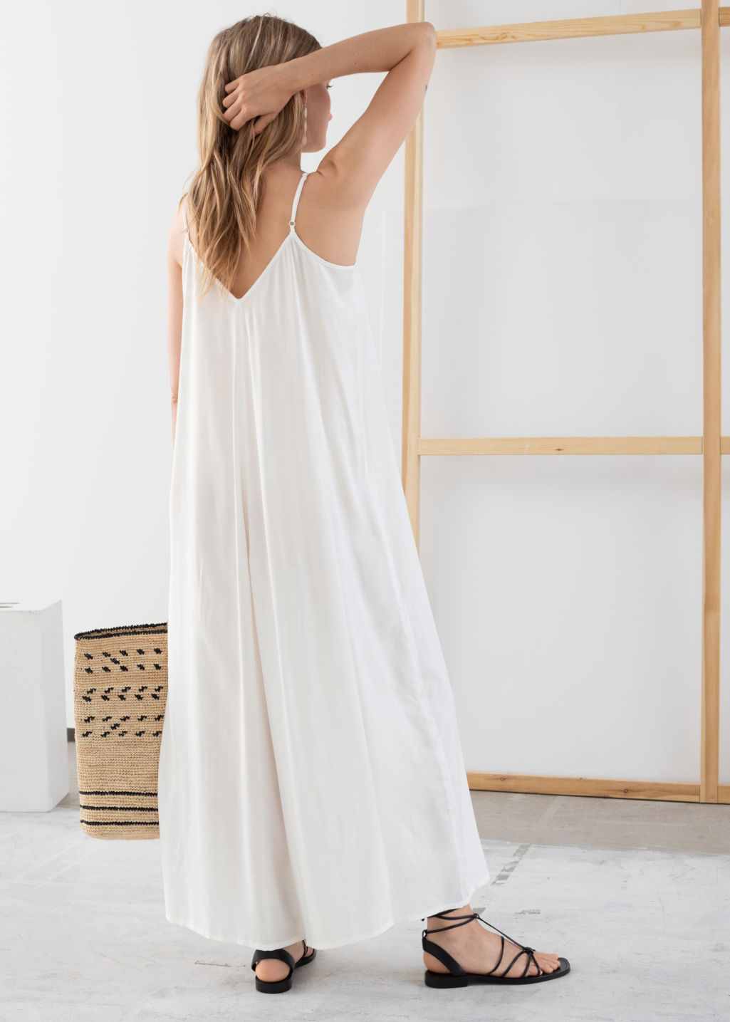 Model back image of Stories relaxed spaghetti strap jumpsuit in white