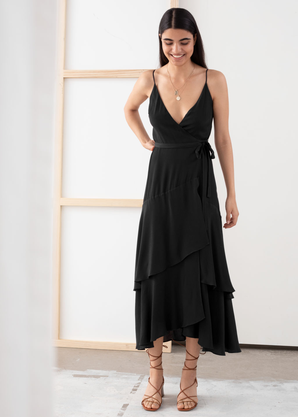 Model front image of Stories ruffled midi wrap dress in black