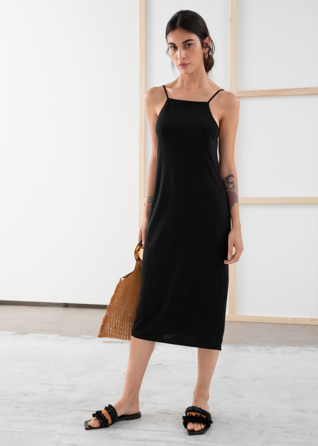 Model front image of Stories square neck midi slip dress in black