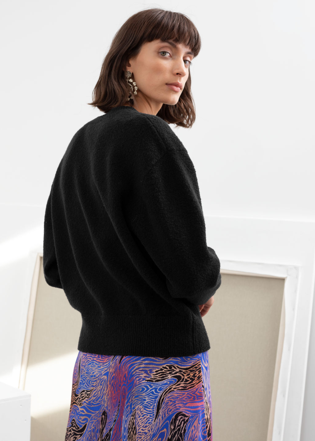 Model back image of Stories textured knit relaxed sweater in black
