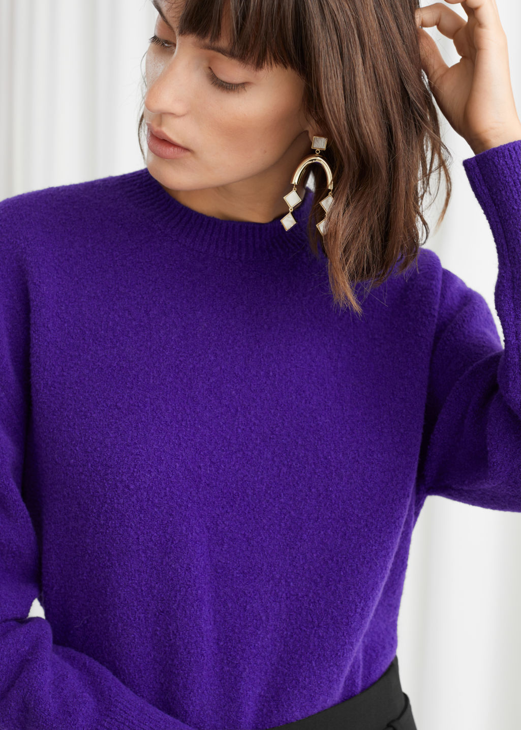 Model front image of Stories textured knit relaxed sweater in purple