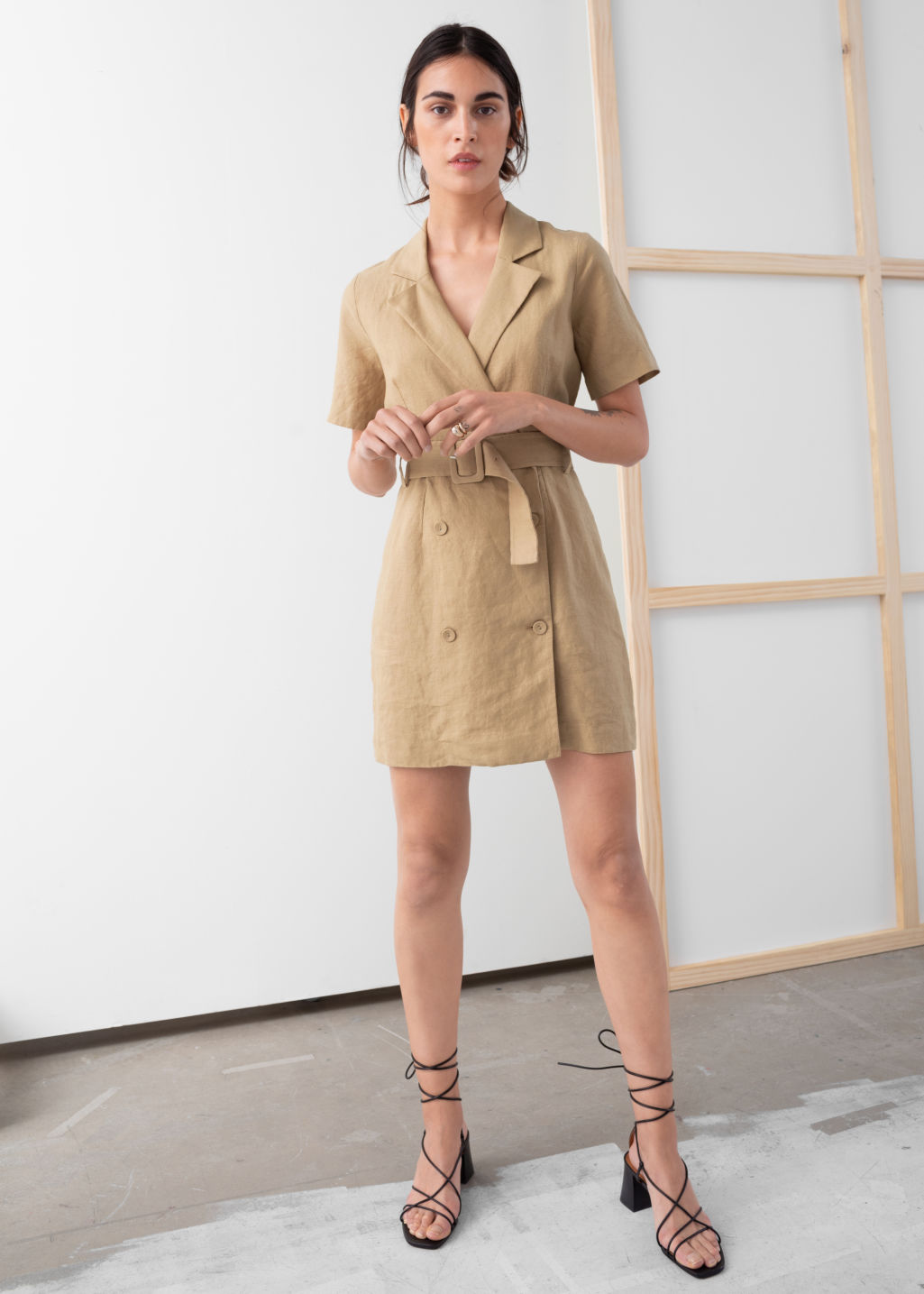 Model front image of Stories belted linen trench mini dress in beige