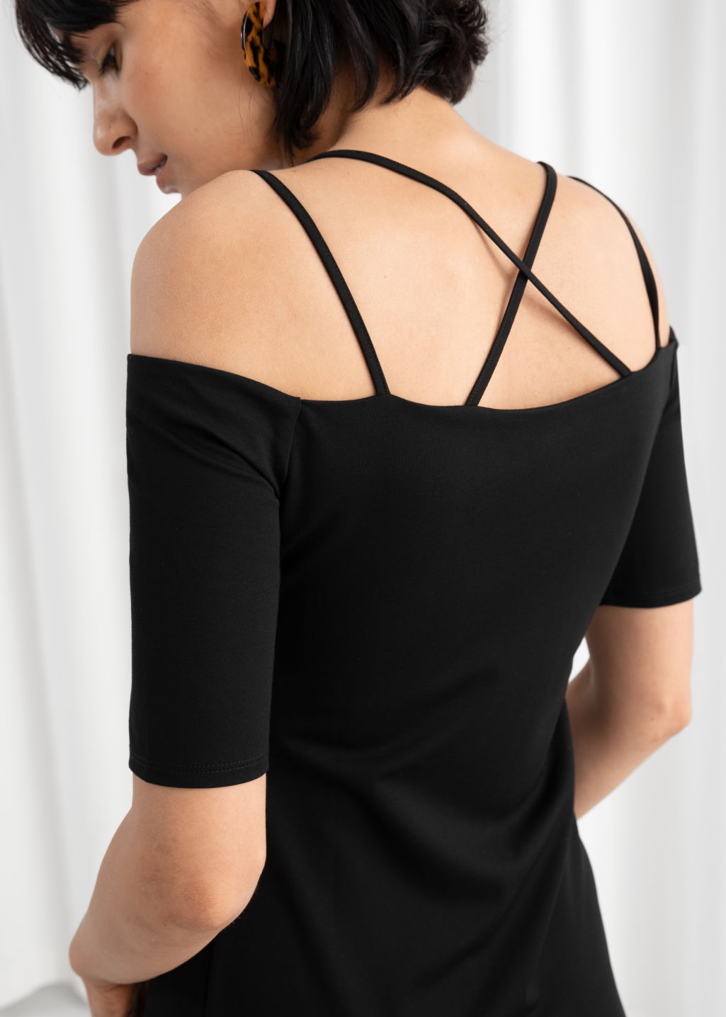 Model back image of Stories off the shoulder midi dress in black