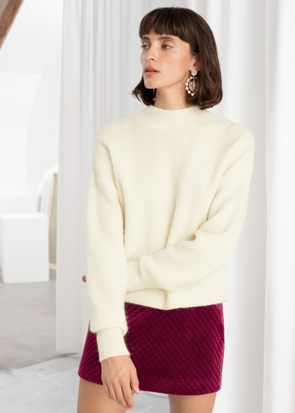 Model front image of Stories ribbed mock neck wool blend sweater in white