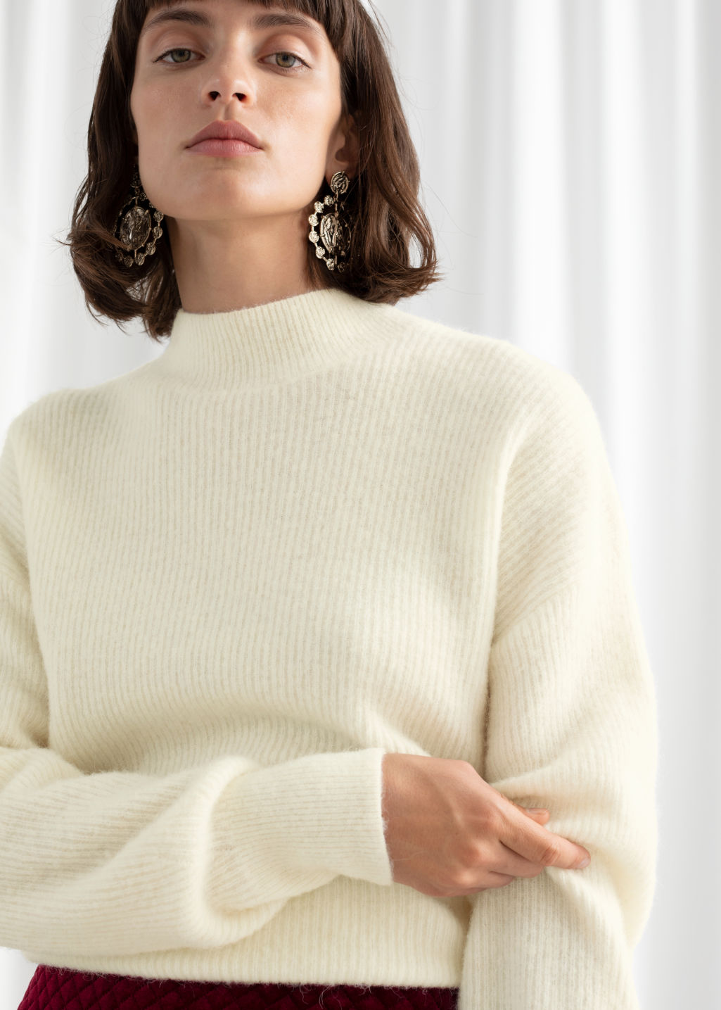 Model back image of Stories ribbed mock neck wool blend sweater in white