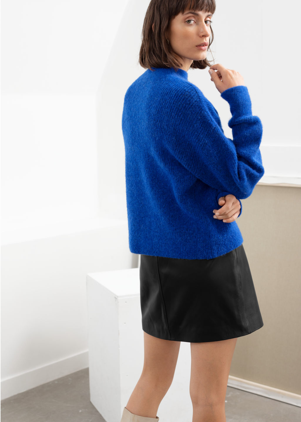 Model back image of Stories ribbed mock neck wool blend sweater in blue