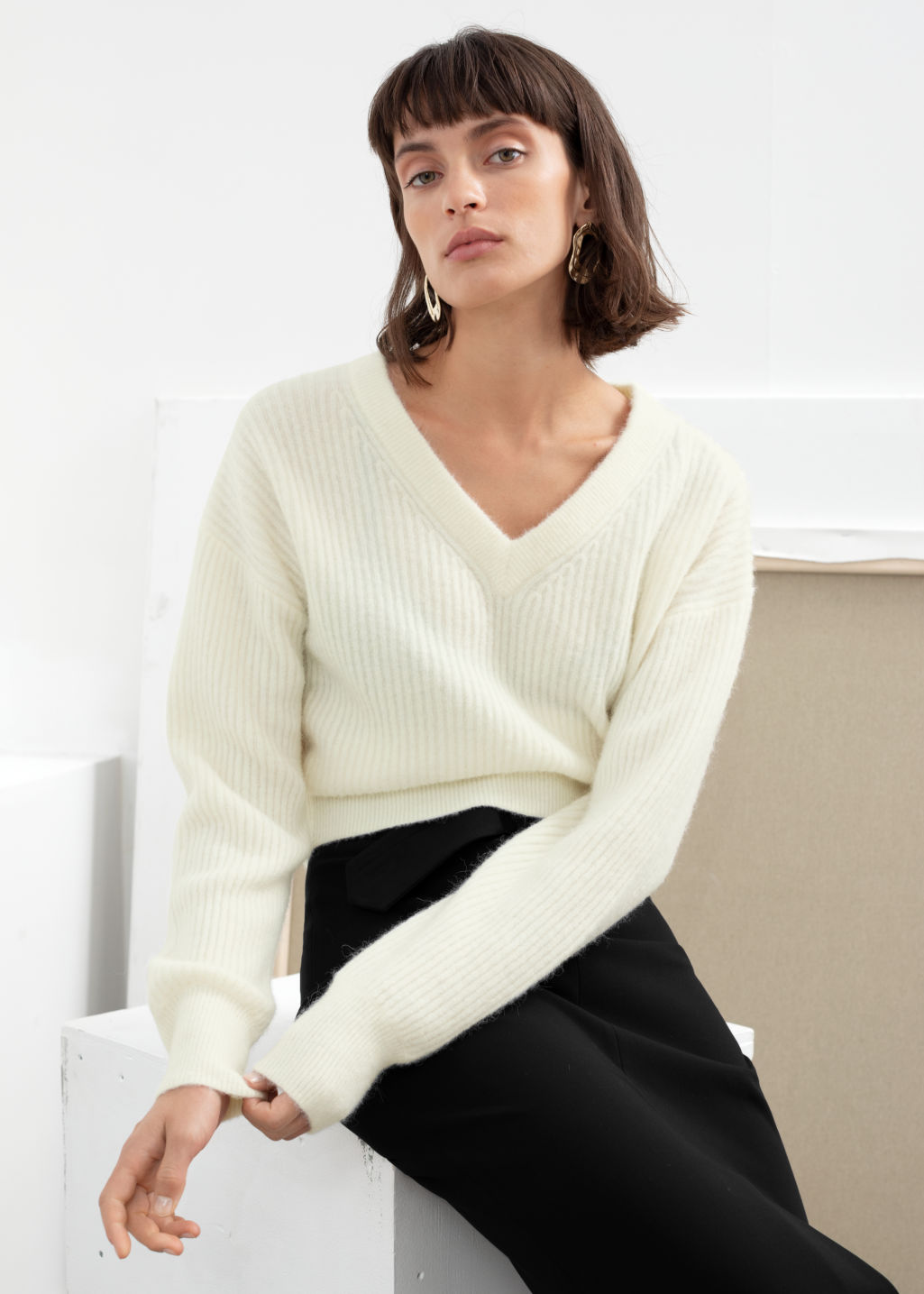 Model front image of Stories ribbed v-neck wool blend sweater in white