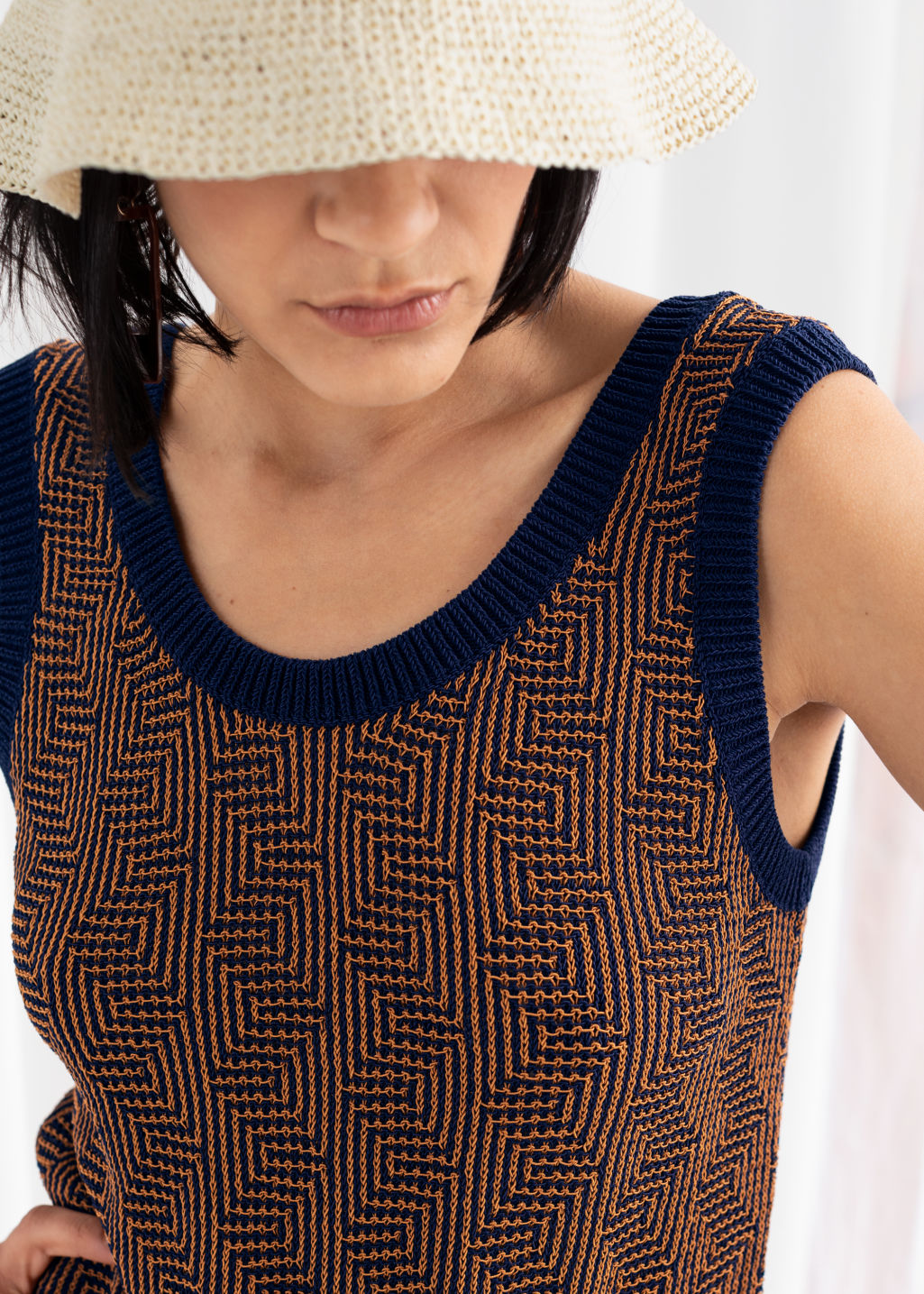 Model back image of Stories cotton geometric micro knit dress in blue