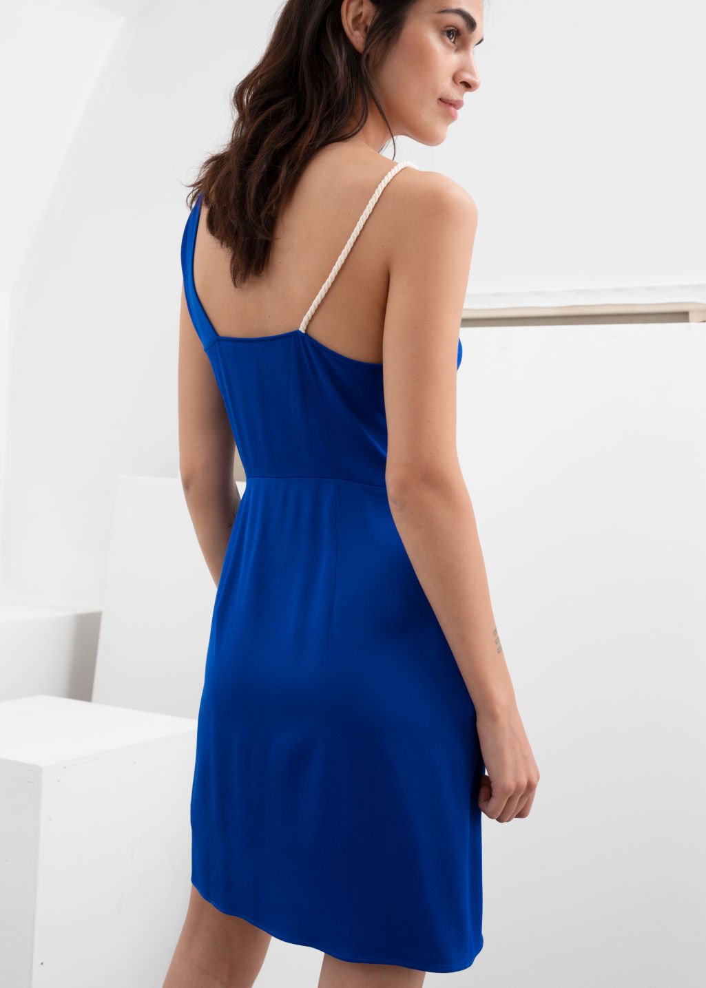 Model back image of Stories rope strap draped mini dress in blue