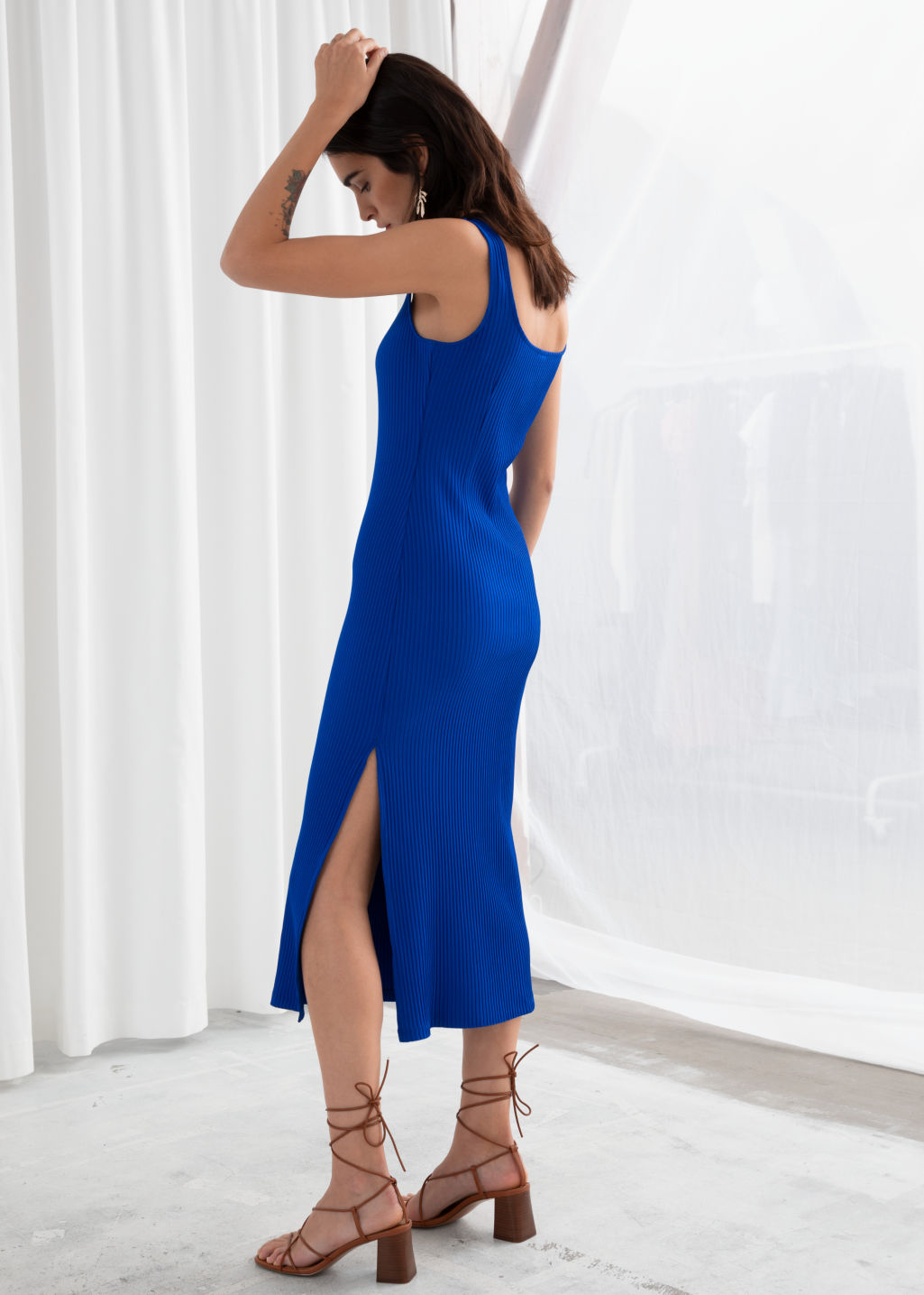 Model back image of Stories ribbed fitted midi dress in blue