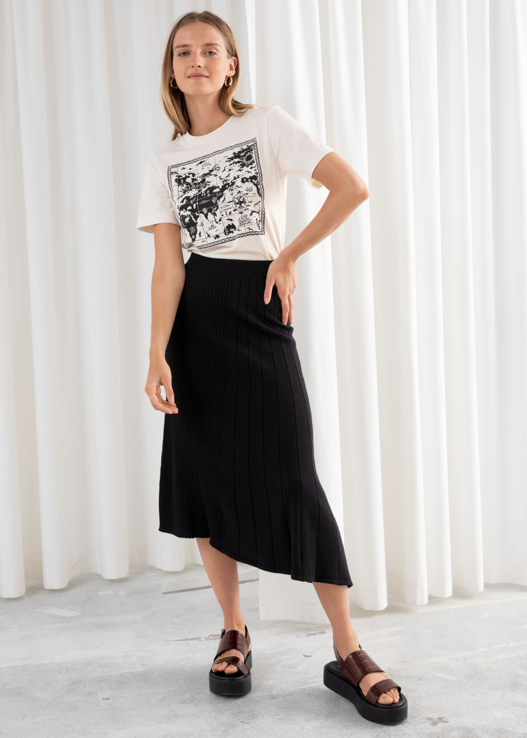Model front image of Stories asymmetrical pleated knit midi skirt in black