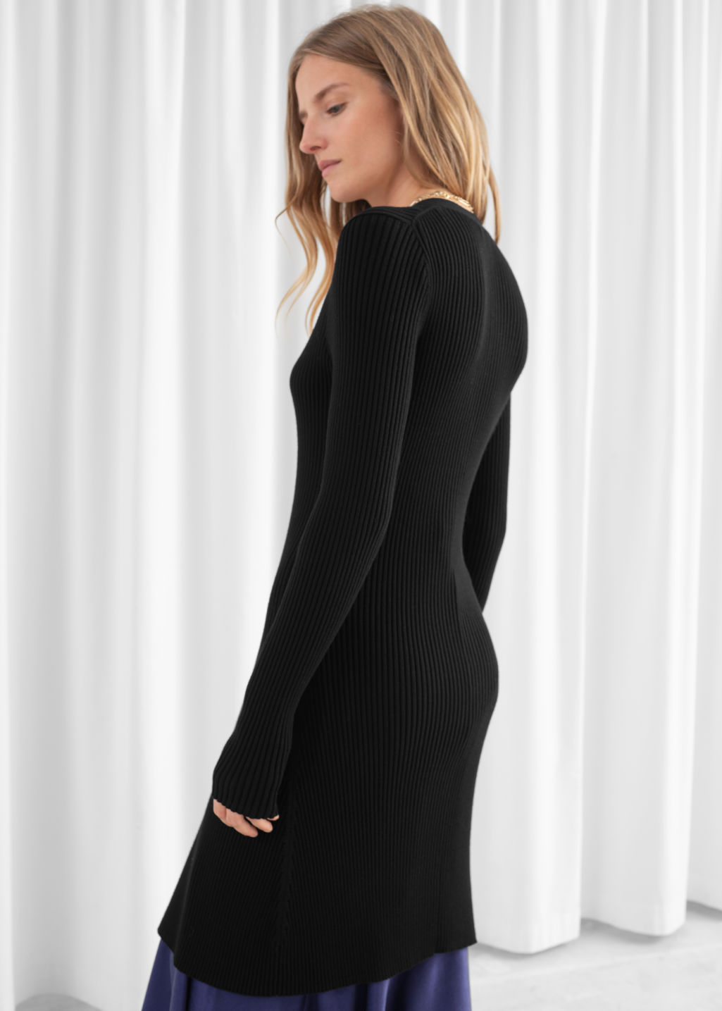Model back image of Stories ribbed knit long cardigan in black