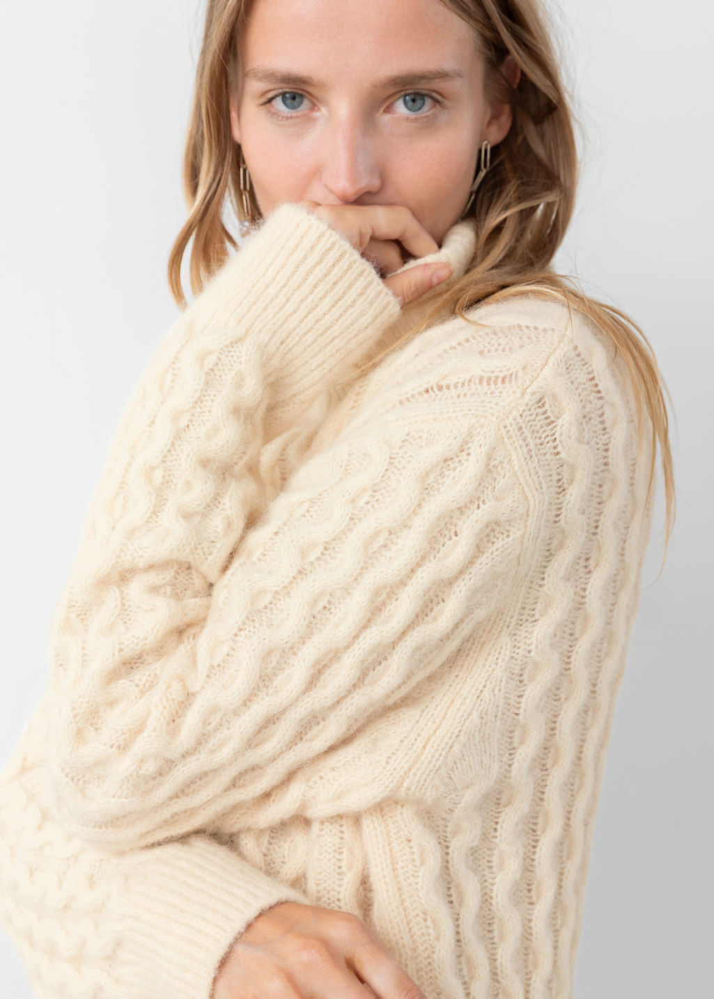 Model back image of Stories cable knit turtleneck sweater in beige