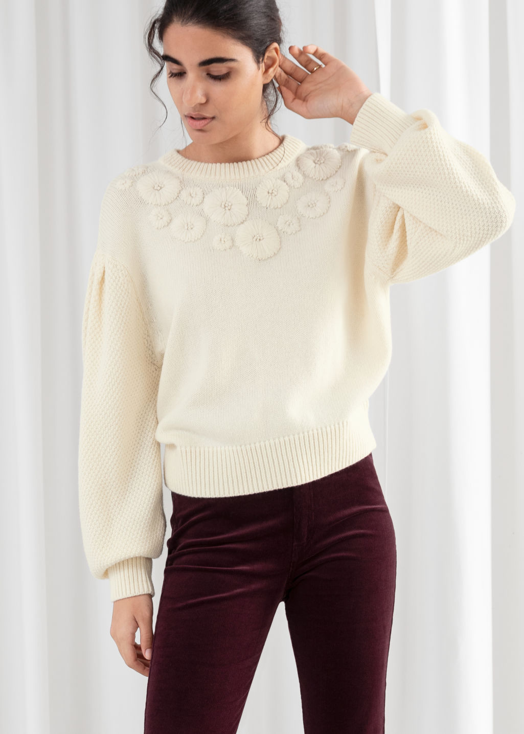 Model front image of Stories floral embroidered wool blend sweater in white