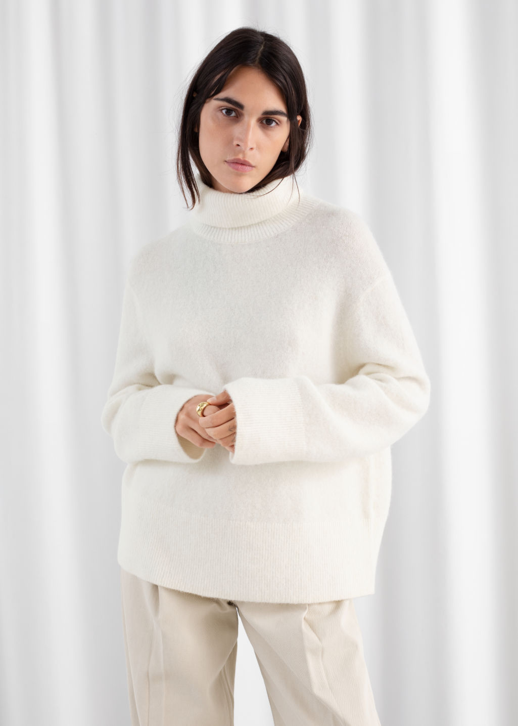 Model front image of Stories alpaca blend turtleneck sweater in white
