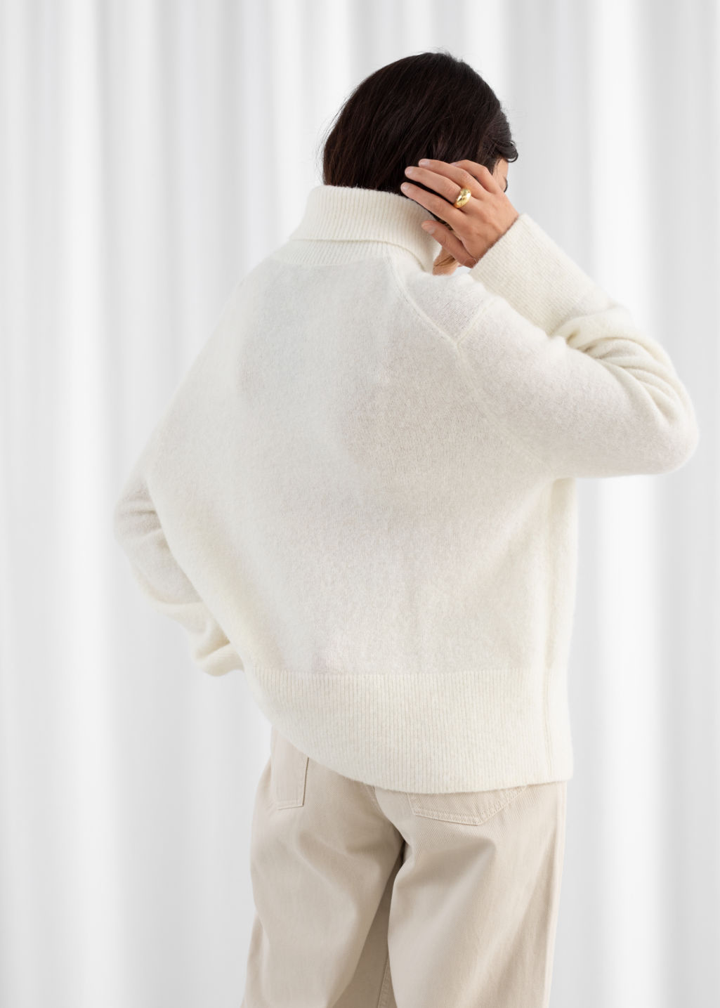 Model back image of Stories alpaca blend turtleneck sweater in white