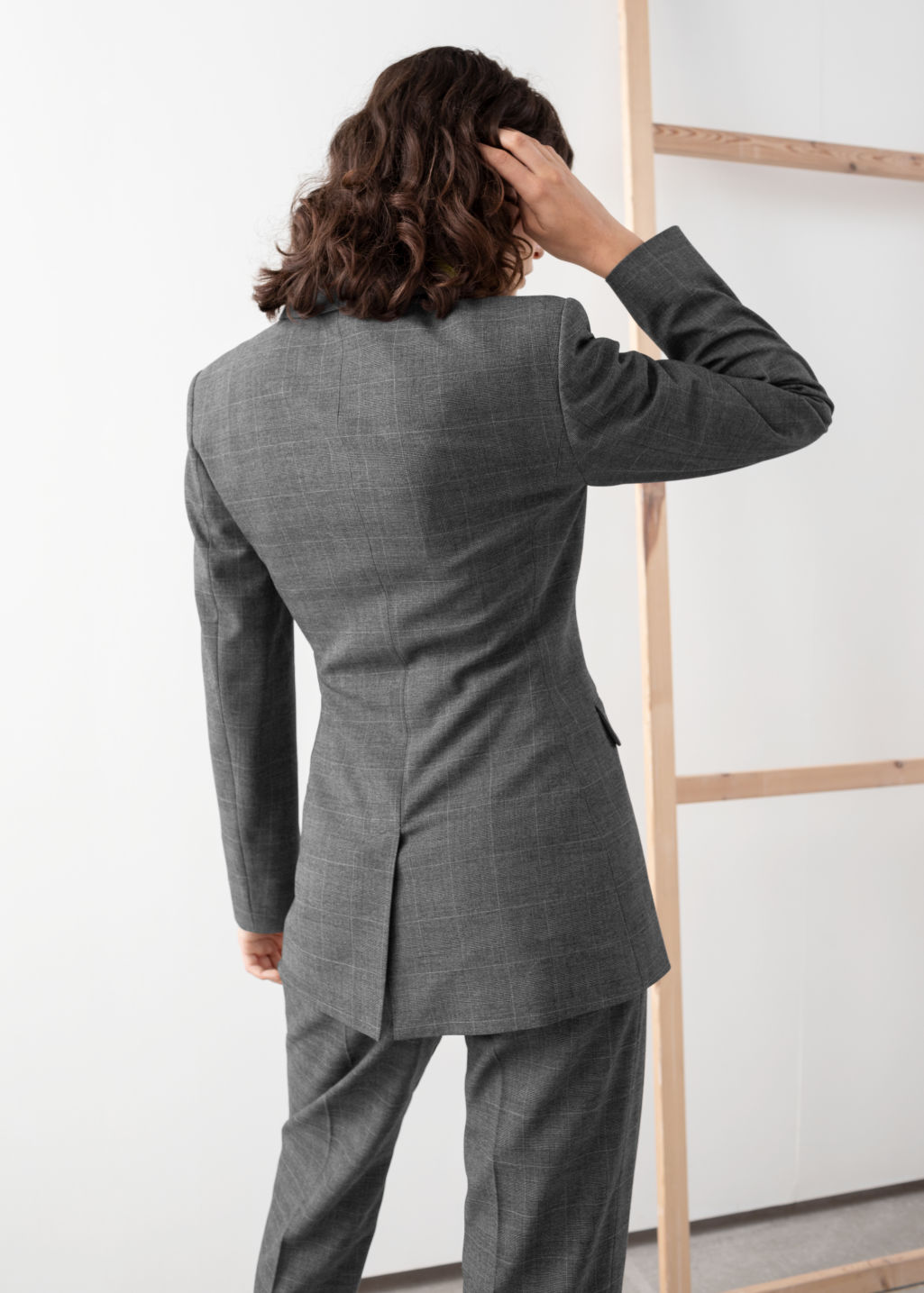 Model back image of Stories asymmetric single button plaid blazer in grey