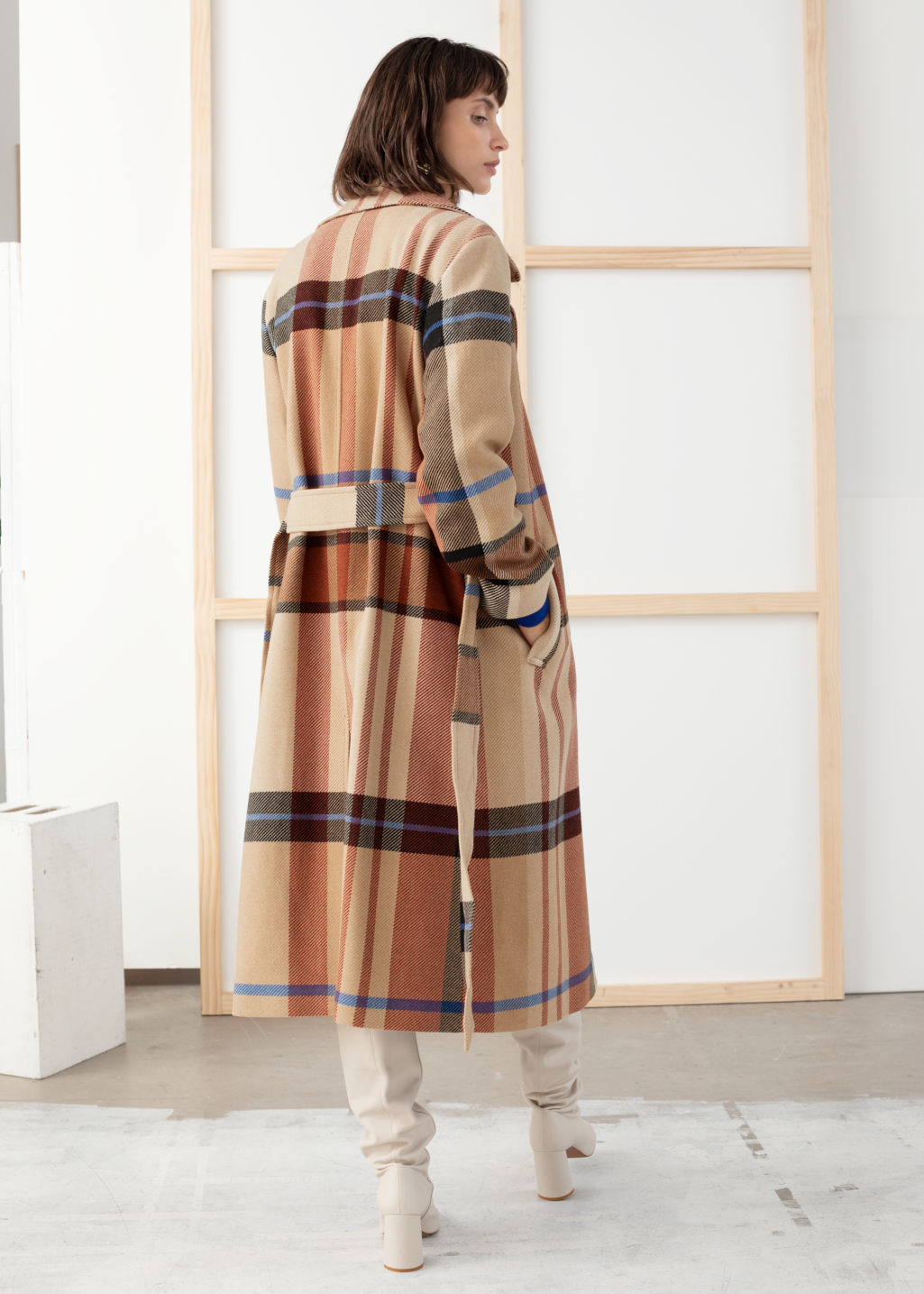 Model back image of Stories plaid wool blend belted long coat in beige