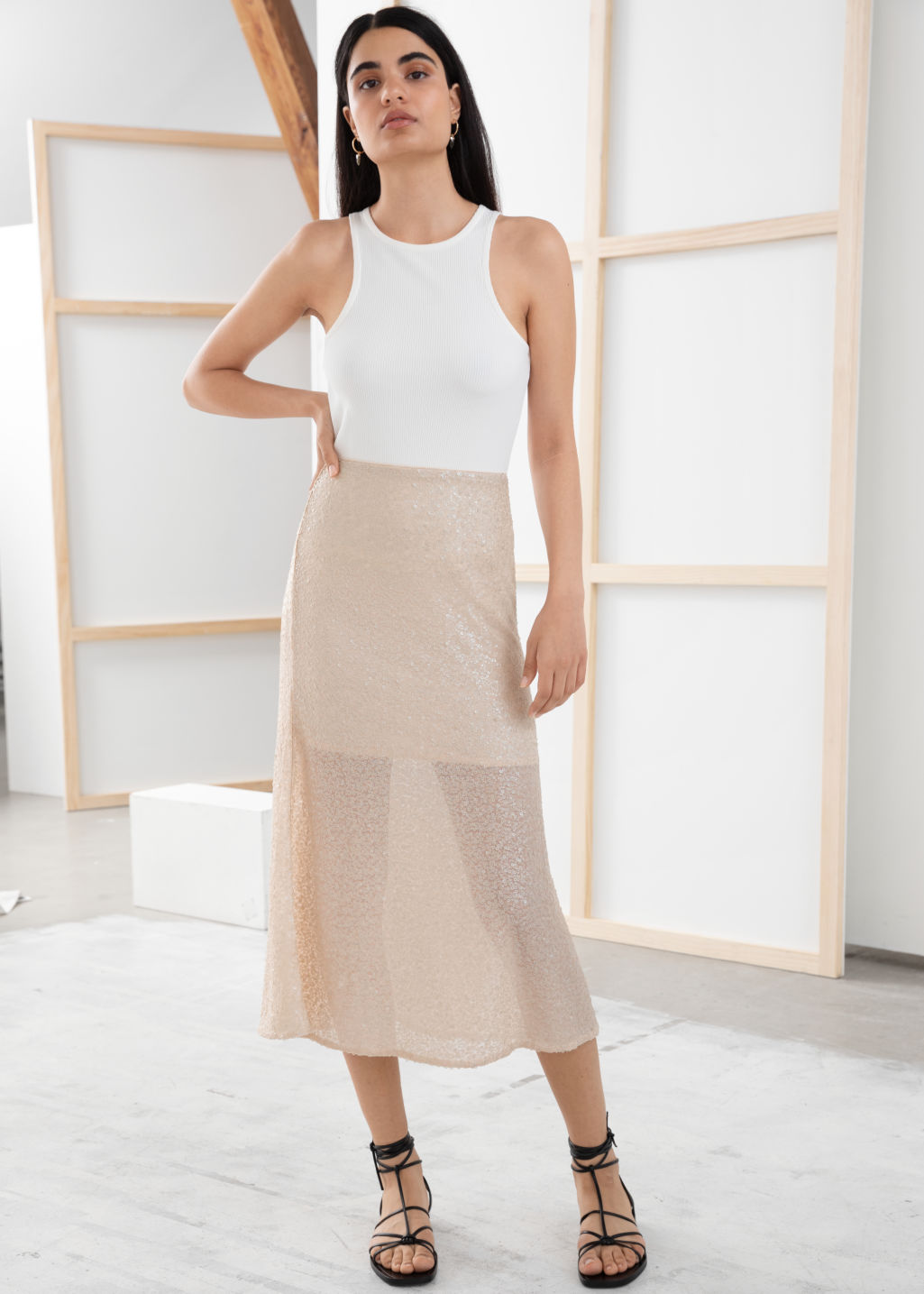 Model front image of Stories sequin embellished midi skirt in beige