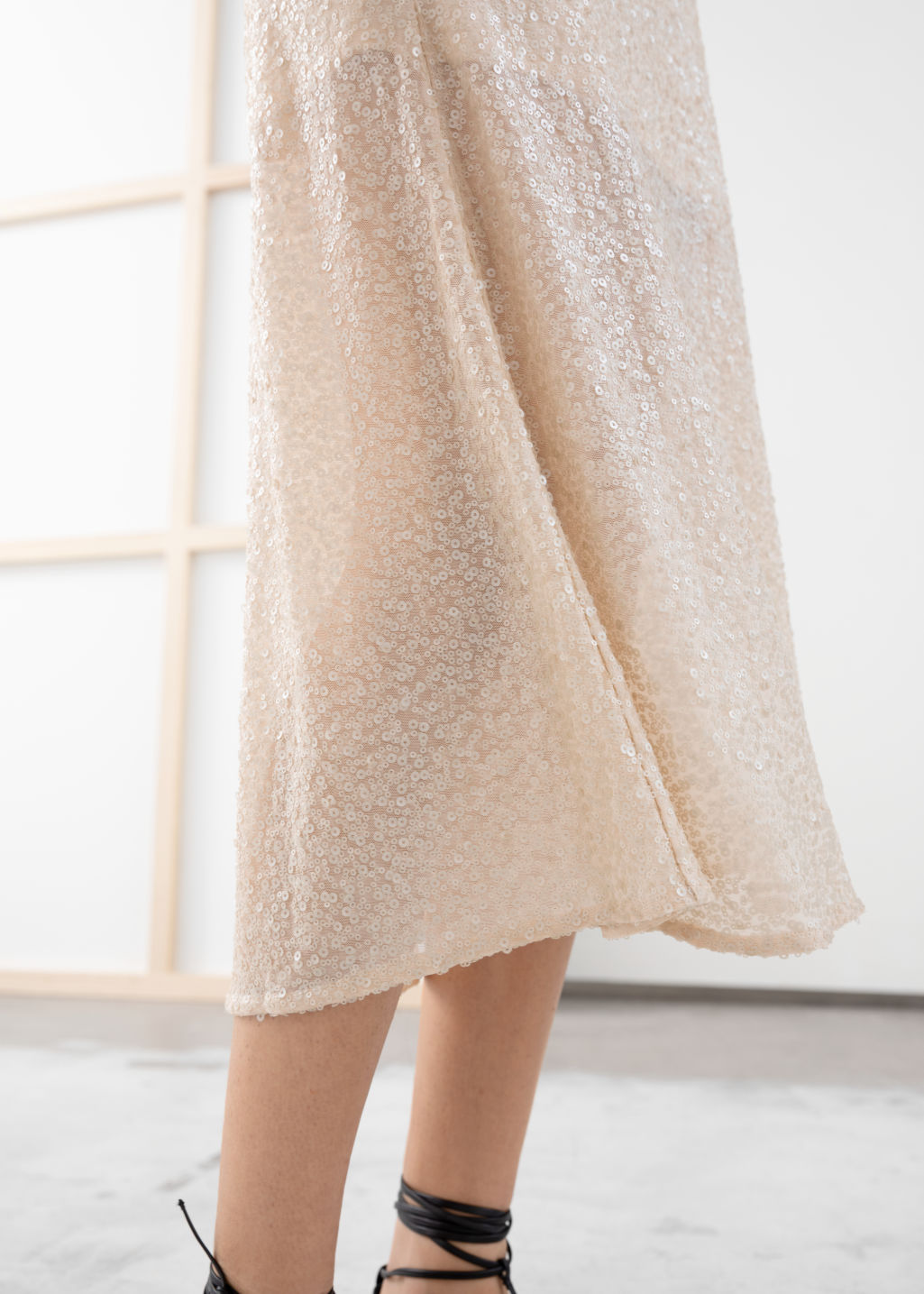 Model back image of Stories sequin embellished midi skirt in beige