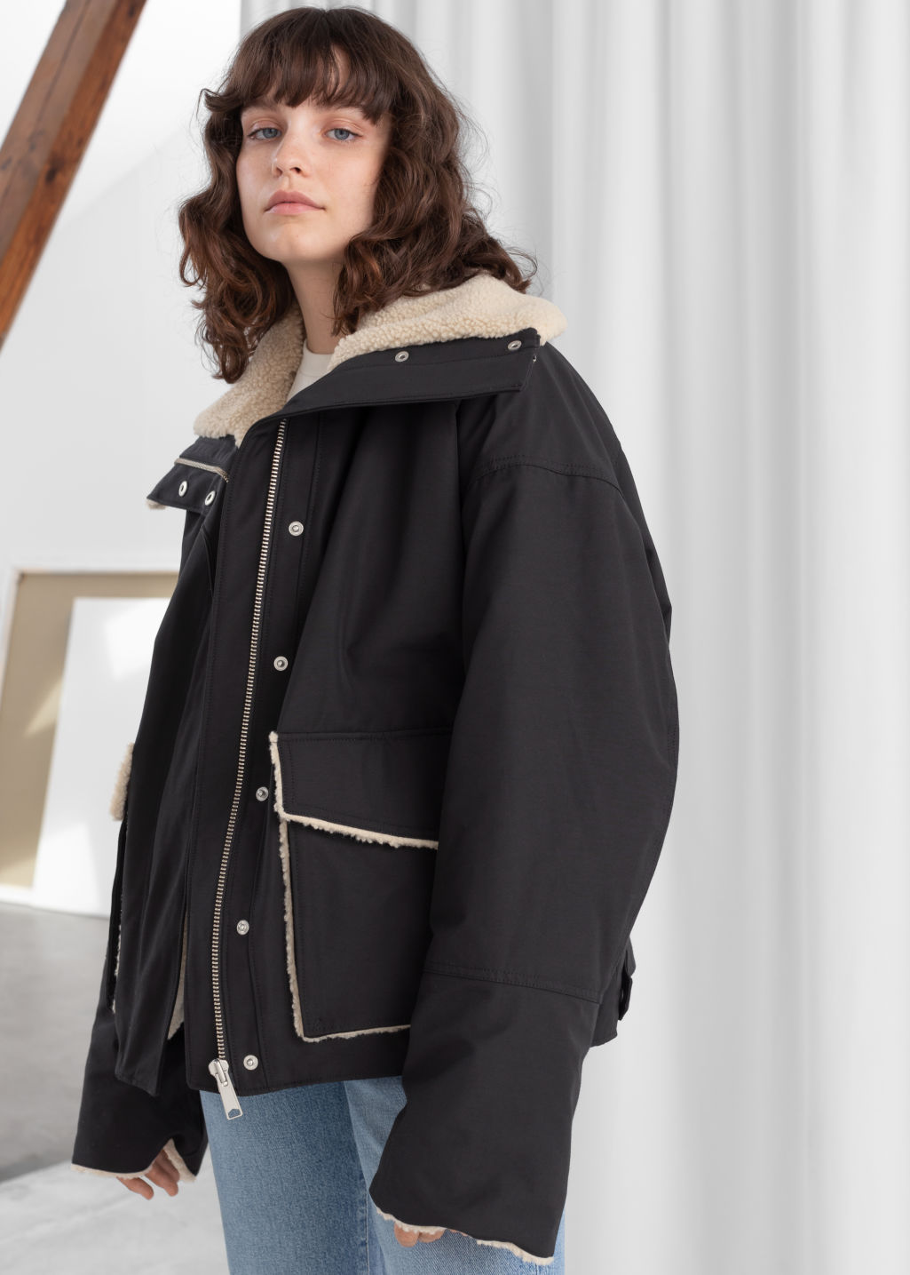 Model front image of Stories oversized faux shearling lined jacket in black