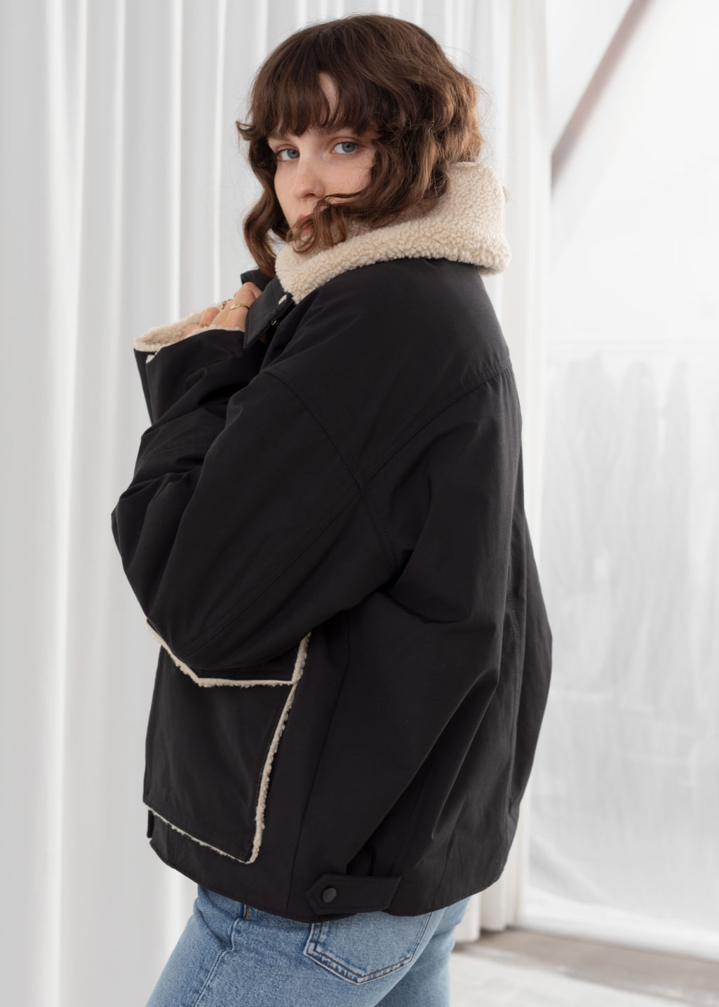 Model back image of Stories oversized faux shearling lined jacket in black