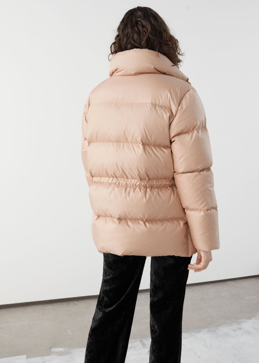 Model back image of Stories drawstring waist puffer jacket in orange