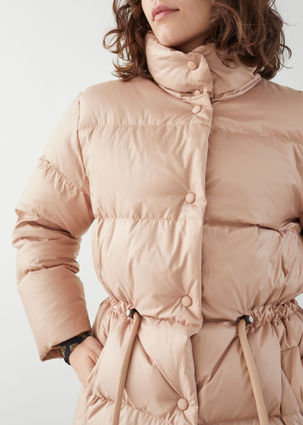 Model front image of Stories drawstring waist puffer jacket in orange