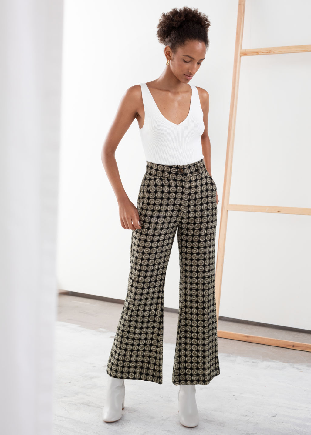Model front image of Stories medallion print flared trousers in black
