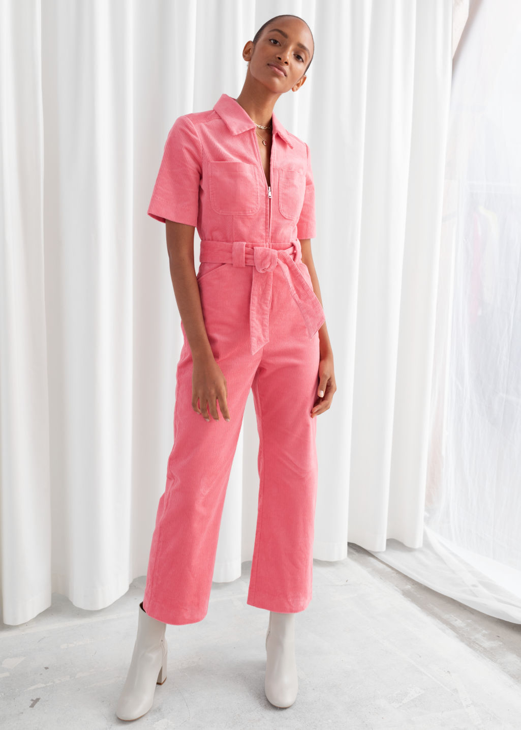 Model front image of Stories corduroy knot belt jumpsuit in pink
