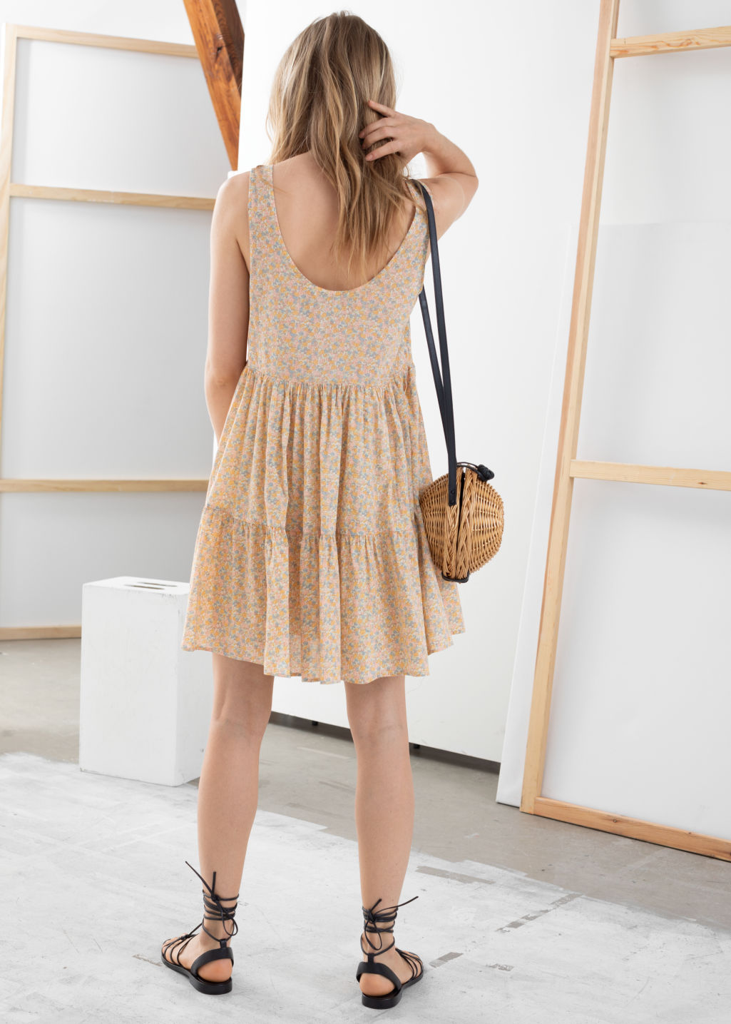Model back image of Stories tiered ruffled mini dress in beige