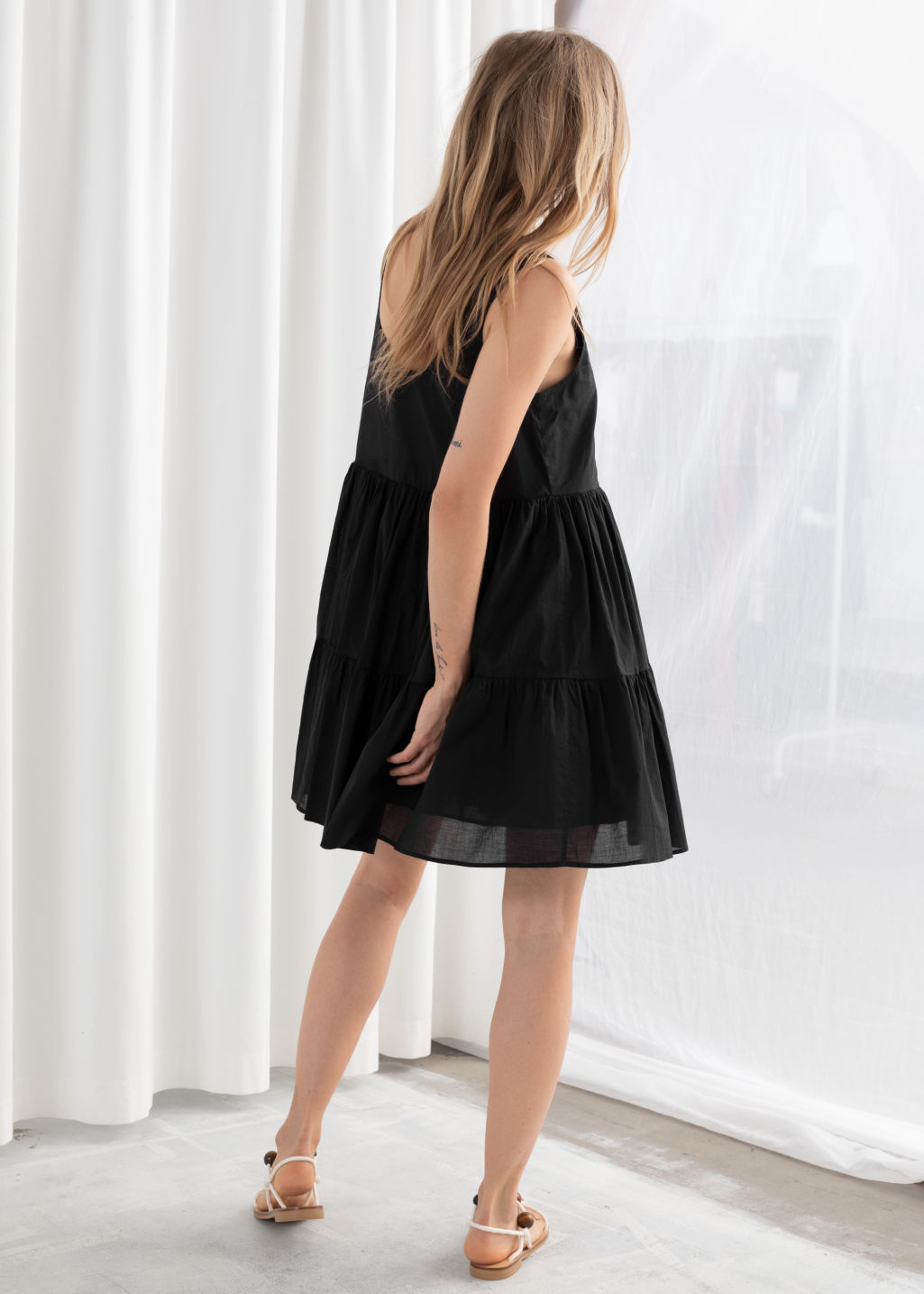 Model back image of Stories tiered ruffled mini dress in black