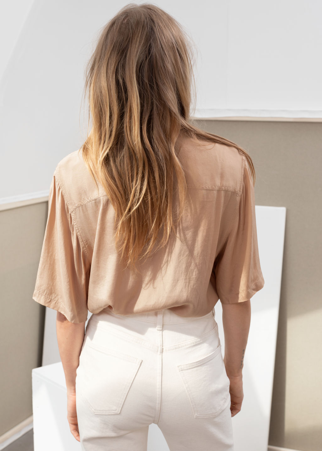 Model back image of Stories satin workwear button up shirt in beige