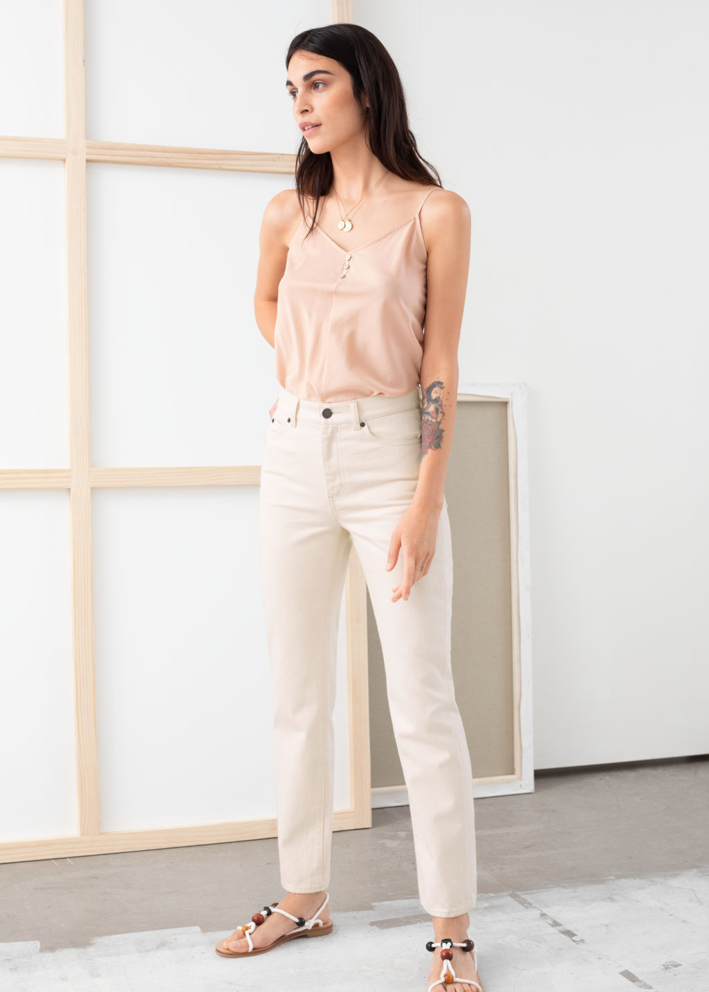 Model front image of Stories slim high rise jeans in white