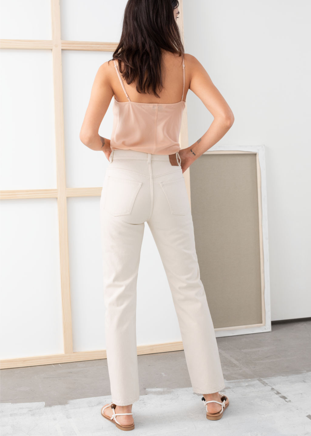Model back image of Stories slim high rise jeans in white