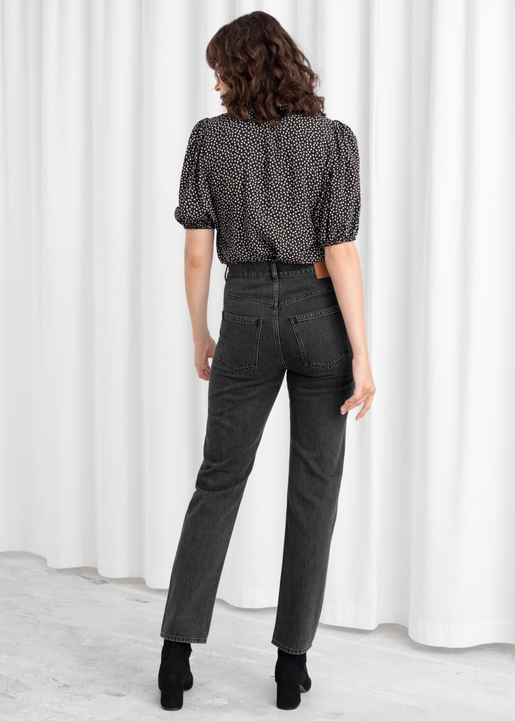 Model back image of Stories slim high rise jeans in black