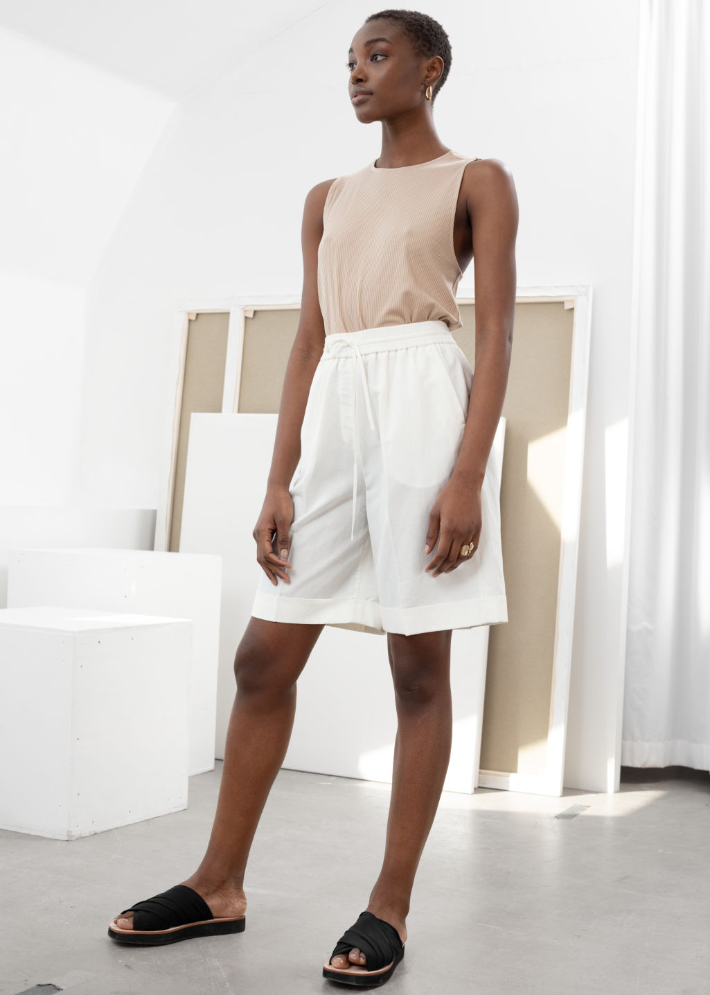 Model front image of Stories drawstring linen blend shorts in white