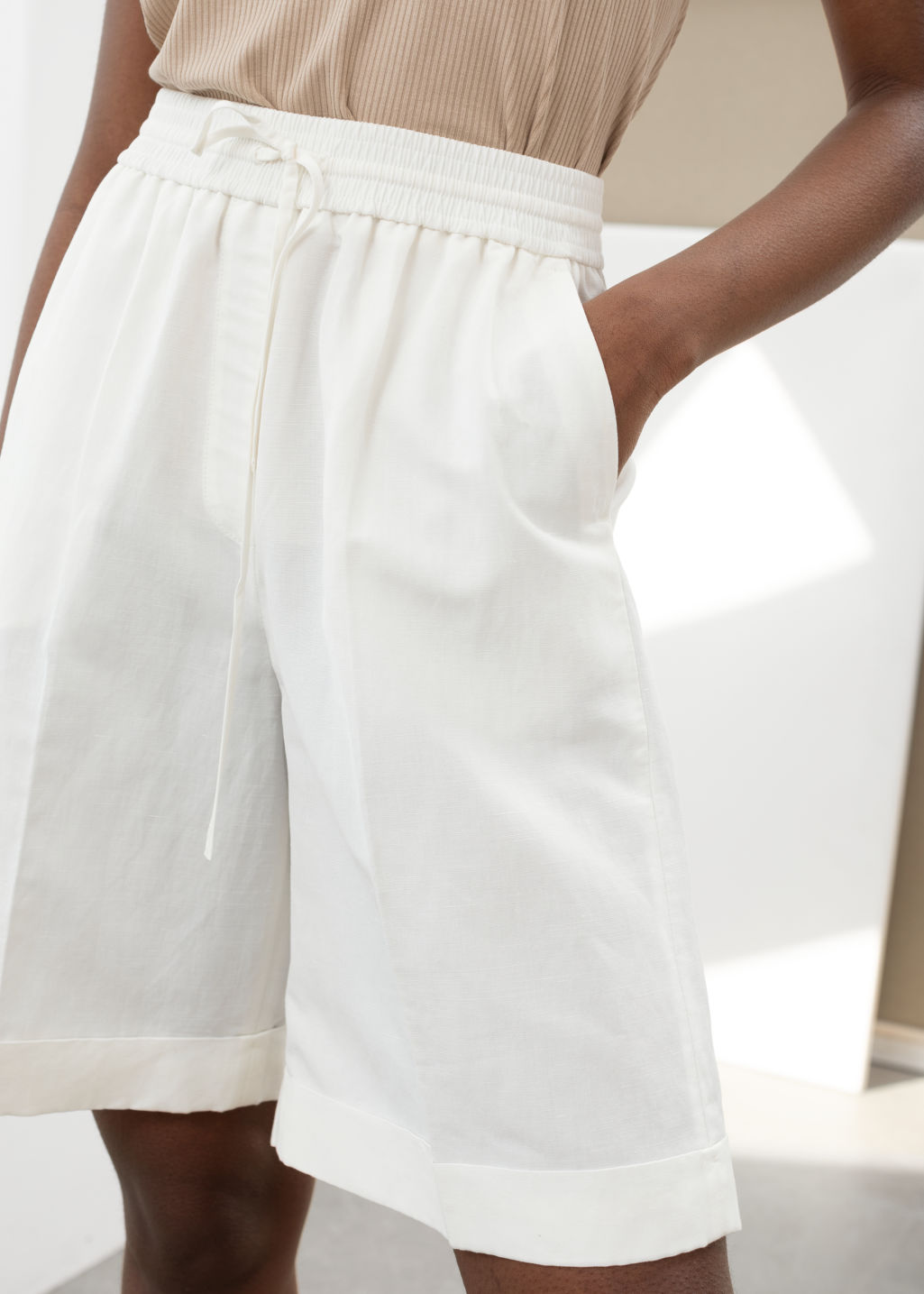 Model back image of Stories drawstring linen blend shorts in white