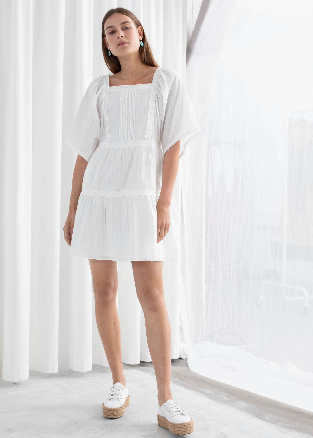Model front image of Stories tiered ruffled cotton mini dress in white