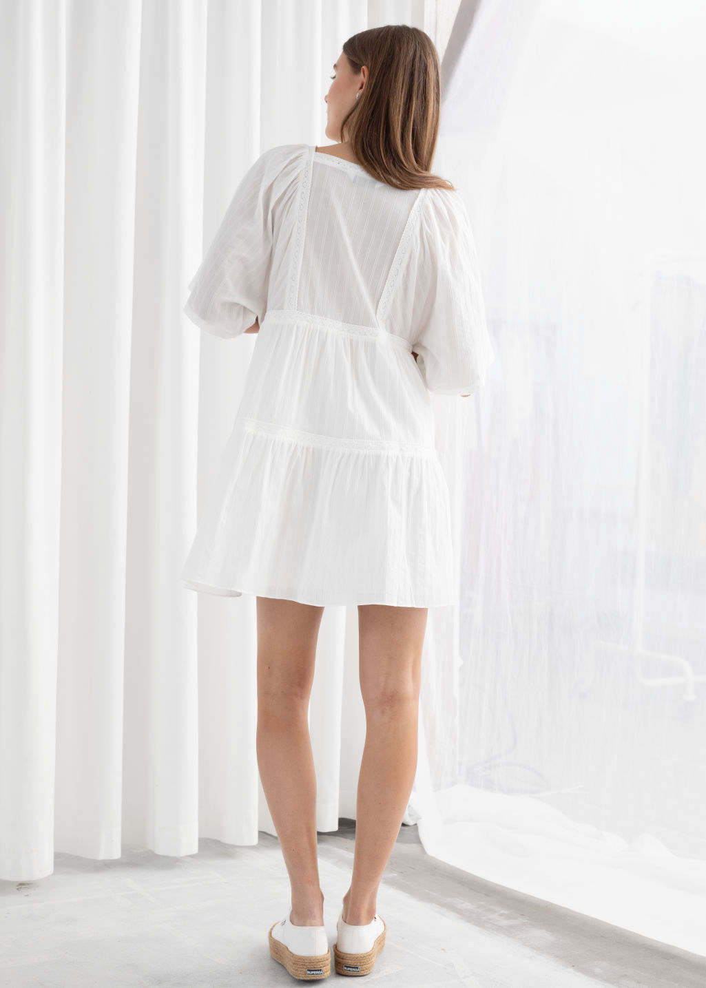 Model back image of Stories tiered ruffled cotton mini dress in white