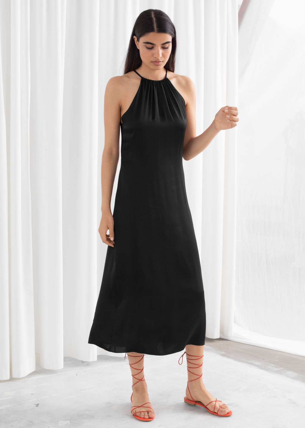 Model front image of Stories gathered halter dress in black