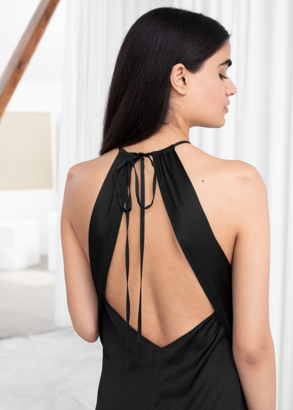 Model back image of Stories gathered halter dress in black