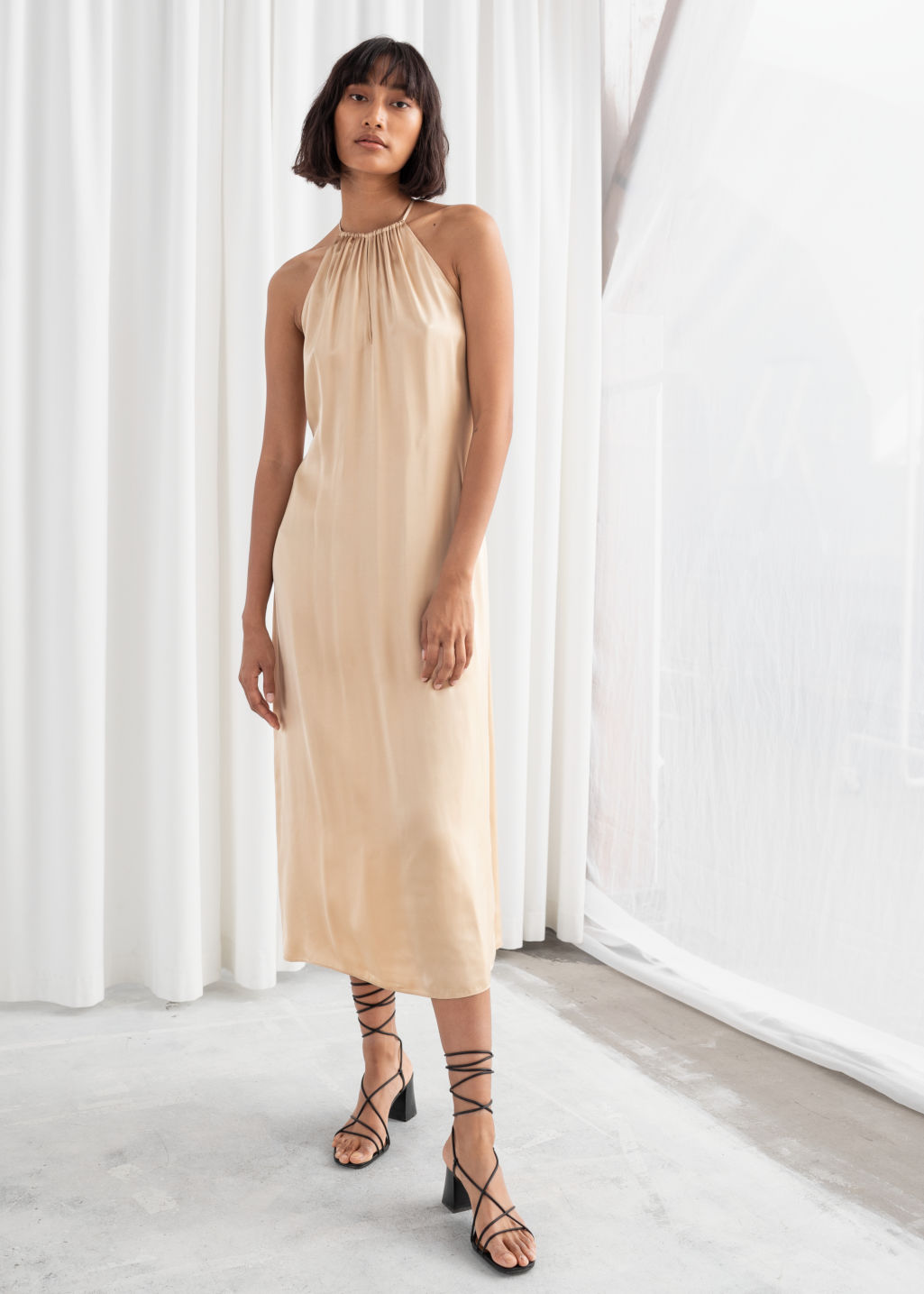Model front image of Stories gathered halter dress in beige