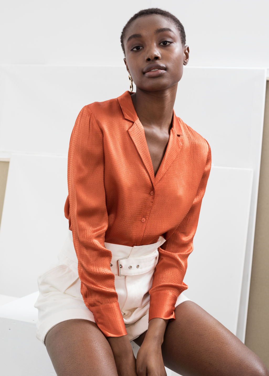 Model front image of Stories button up satin blouse in orange
