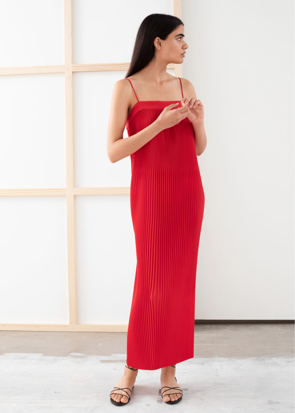 Model front image of Stories plissé pleated midi dress in red